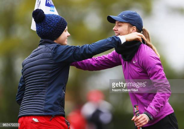 Elena Moosmann embraces Chloe Gibbs on the 18th green during the second round of the Girls' U16 Open Championship at Fulford Golf Club on April 28...