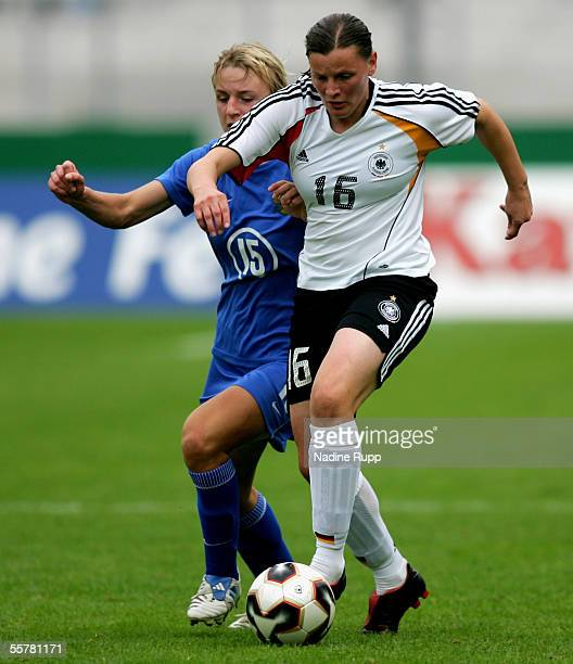 Elena Morozova of Russia competes with Pia Wunderlich of Germany during the women's World Cup qualifying match between Germany and Czech Russia at...