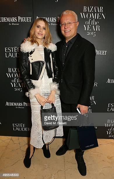 Elena Perminova and Alexander Lebedev attend the Harper's Bazaar Women of the Year Awards 2015 at Claridges Hotel on November 3 2015 in London England