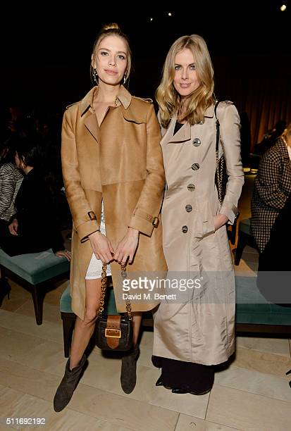Elena Perminova and Donna Air wearing Burberry at the Burberry Womenswear February 2016 Show at Kensington Gardens on February 22 2016 in London...