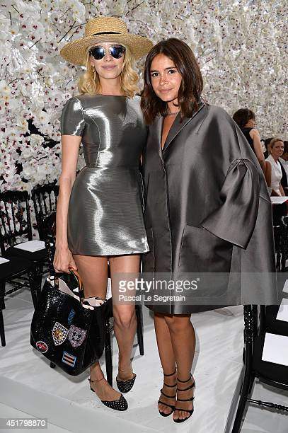 Elena Perminova and Miroslava Duma attend the Christian Dior show as part of Paris Fashion Week Haute Couture Fall/Winter 20142015 on July 7 2014 in...