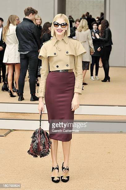 Elena Perminova arrives at Burberry Prorsum Womenswear Spring/Summer 2014 show during London Fashion Week at Kensington Gardens on September 16, 2013...