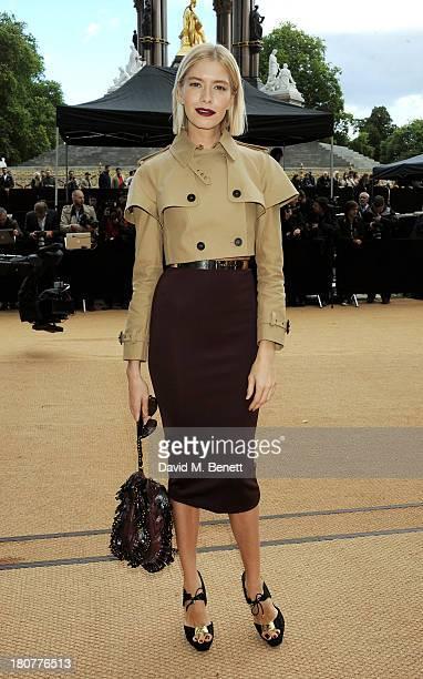 Elena Perminova arrives at Burberry Prorsum Womenswear Spring/Summer 2014 show during London Fashion Week at Kensington Gardens on September 16 2013...