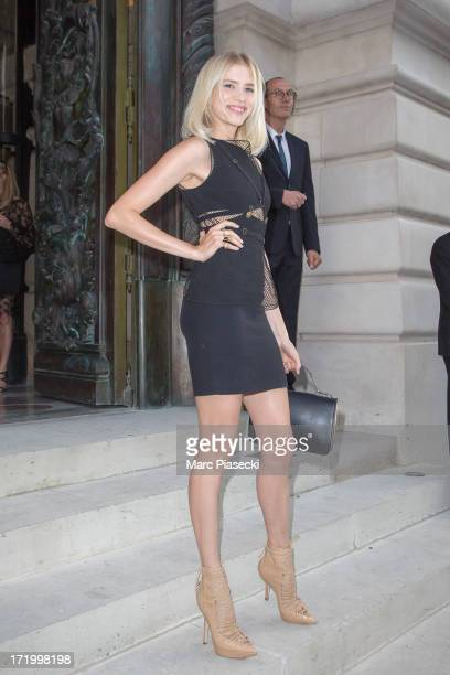 Elena Perminova arrives to attend the Versace show as part of Paris Fashion Week HauteCouture Fall/Winter 20132014 on June 30 2013 in Paris France