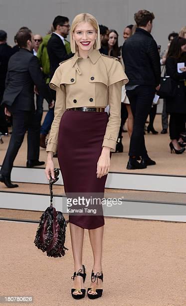 Elena Perminova attends the Burberry Prorsum show during London Fashion Week SS14 at Kensington Gardens on September 16 2013 in London England