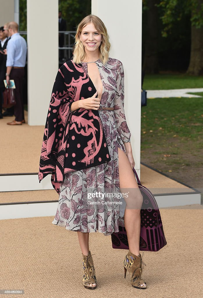 Elena Perminova attends the Burberry Womenswear SS15 show during London Fashion Week at Kensington Gardens on September 15, 2014 in London, England.