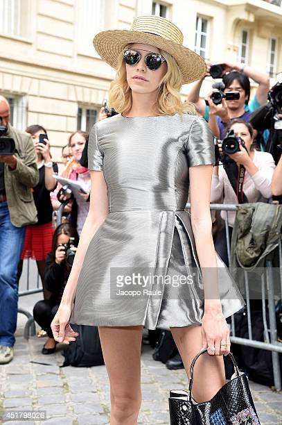Elena Perminova attends the Dior show as part of Paris Fashion Week Haute Couture Fall/Winter 20142015 on July 7 2014 in Paris France