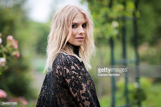 Elena Perminova attends the Ulyana Sergeenko Haute Couture Fall/Winter 20162017 show as part of Paris Fashion Week on July 3 2016 in Paris France