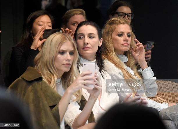 Elena Perminova Erin O'Connor and Laura Bailey wearing Burberry attends the Burberry February 2017 Show during London Fashion Week February 2017 at...