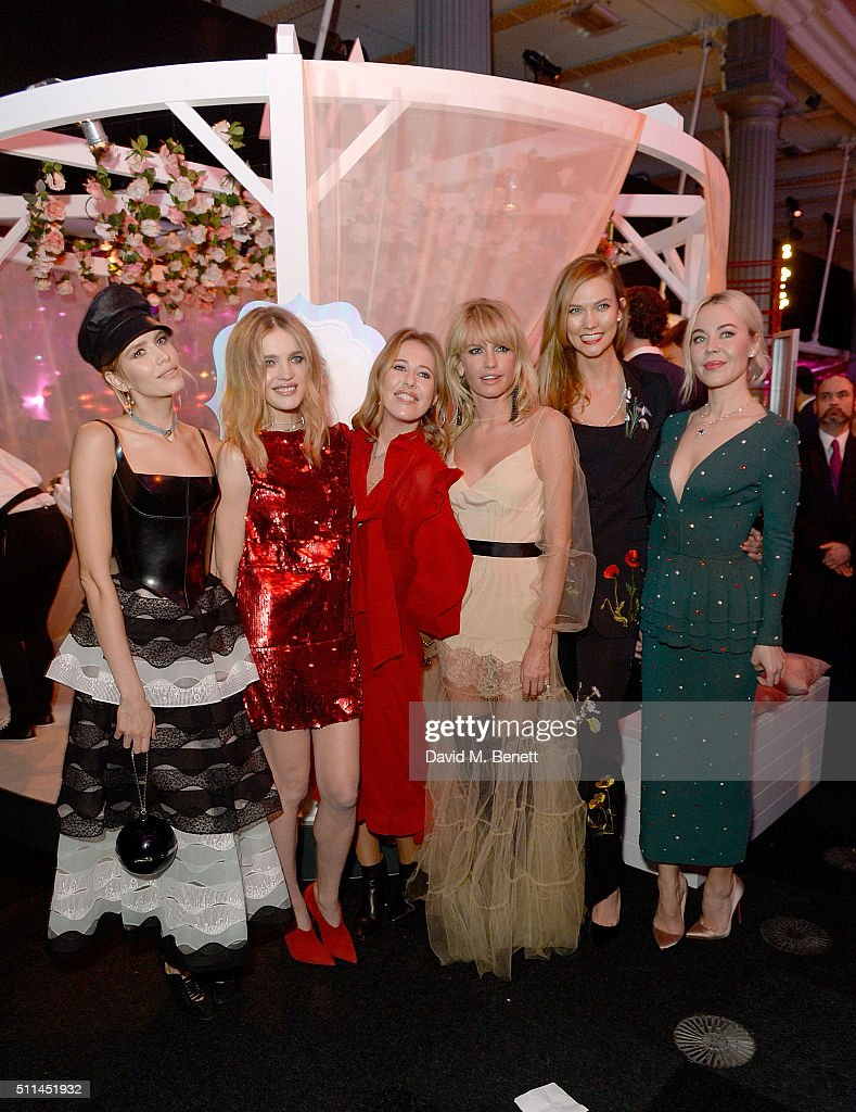 Elena Perminova (L) Natalia Vodianova (2nd L) and Karlie Kloss (2nd R) with guests at The Naked Heart Foundation's Fabulous Fund Fair in London at Old Billingsgate Market on February 20, 2016 in London, England.