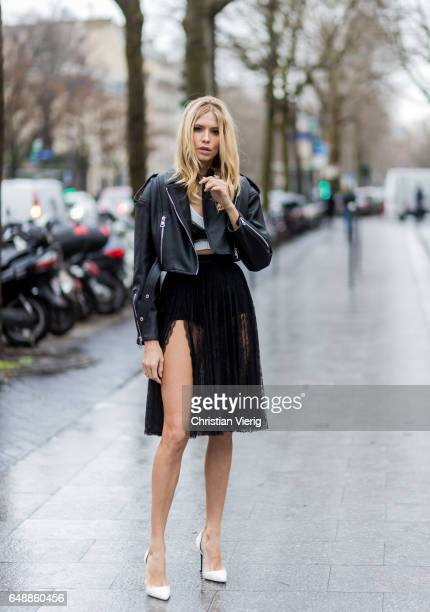 Elena Perminova wearing a black skirt black cropped leather jacket outside Giambattista Valli on March 6 2017 in Paris France