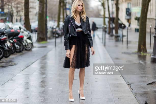 Elena Perminova wearing a black skirt black cropped leather jacket outside Giambattista Valli on March 6 2017 in Paris France