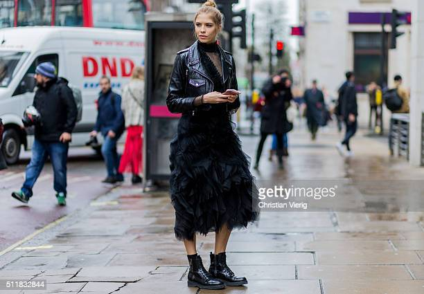 Elena Perminova wearing a leather jacket and a black dress seen outside Erdem during London Fashion Week Autumn/Winter 2016/17 on February 22 2016 in...