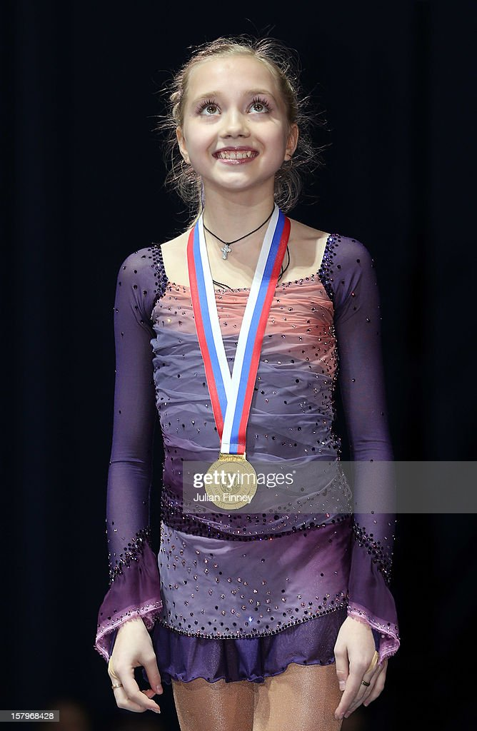 Elena Radionova of Russia smiles with her gold medal in the Junior Ladies Free Skating during the Grand Prix of Figure Skating Final 2012 at the Iceberg Skating Palace on December 8, 2012 in Sochi, Russia.