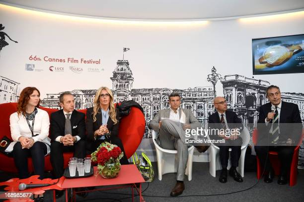 Elena Romanova Tiziana Rocca Riccardo Monti listen to Mario Sesti during the Taromina Film Festival Presentation at The 66th Annual Cannes Film...