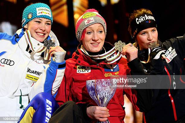 Elena Runggaldier of Italy, Daniela Iraschko of Austria and Coline Mattel of France celebrate with the medals won in the Ladies Ski Jumping...