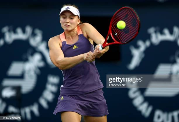 Elena Rybakina of Kazakhstan plays a backhand against Petra Martic of Croatia during the women's singles semi-final match on Day Five of the Dubai...