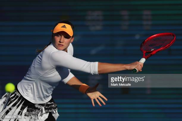 Elena Rybakina of Kazakhstan plays a backhand during her semi final singles match against Heather Watson of Great Britain during day seven of the...