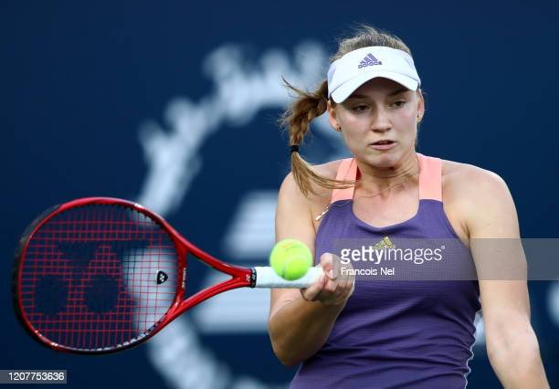 Elena Rybakina of Kazakhstan plays a forehand against Petra Martic of Croatia during the women's singles semi-final match on Day Five of the Dubai...