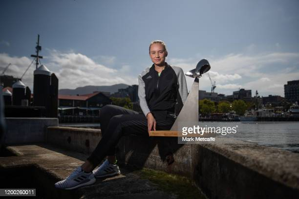 Elena Rybakina of Kazakhstan poses with the Hobart International trophy at Hobart's waterfront after winning her final singles match against Zhang...