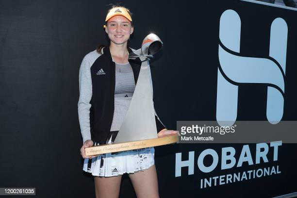 Elena Rybakina of Kazakhstan poses with the Hobart International trophy after winning her final singles match against Zhang Shuai of China during day...