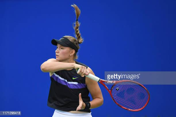 Elena Rybakina of Kazakhstan returns a shot during the match against Aryna Sabalenka of Belarus on Day 5 of 2019 Dongfeng Motor Wuhan Open at Optics...