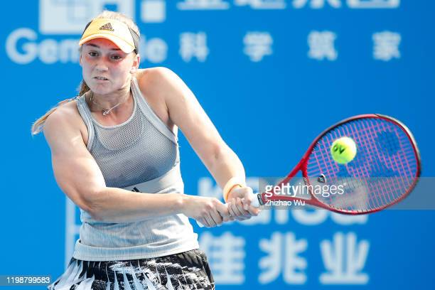 Elena Rybakina of Kazakhstan returns a shot during the women's singles final match against Ekaterina Alexandrova of Russia on day 7 of the 2020 WTA...