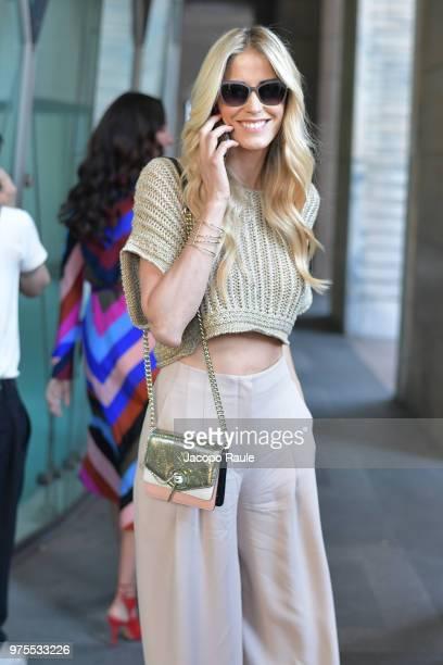 Elena Santarelli is seen during Milan Men's Fashion Week Spring/Summer 2019 on June 15, 2018 in Milan, Italy.