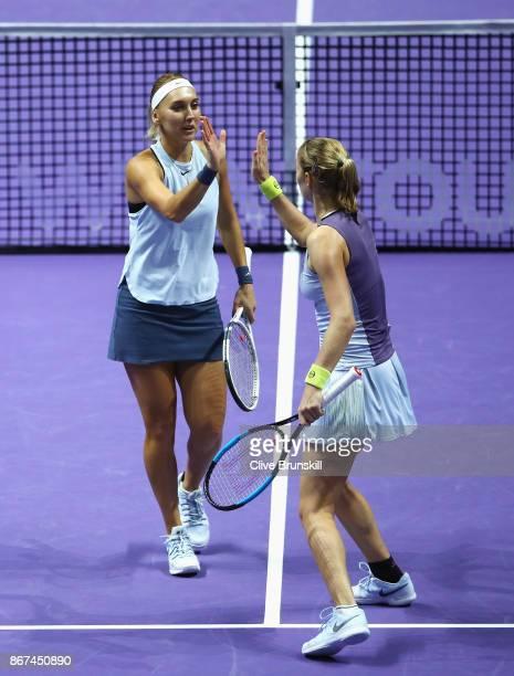 Elena Vesnina and Ekaterina Makarova of Russia celebrate a point in the doubles semi final match against Kiki Bertens of Netherlands and Johanna...