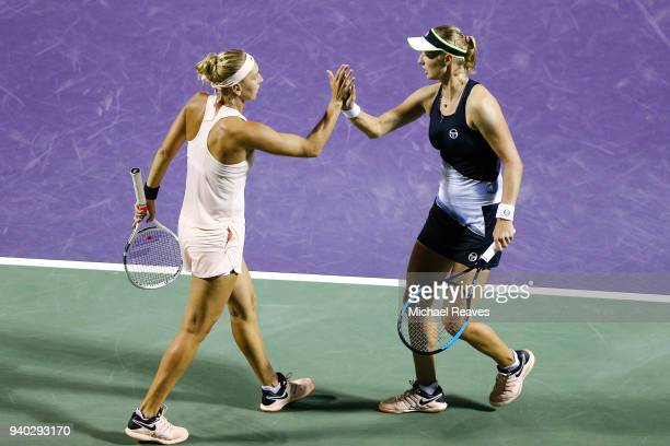 Elena Vesnina and Ekaterina Makarova of Russia celebrate after a point against Ashleigh Barty of Australia and CoCo Vandeweghe of the United States...