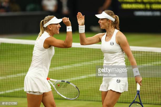Elena Vesnina and Ekaterina Makarova of Russia celebrate in the Ladies Doubles Final against HaoChing Chan of Chinese Taipei and Monica Niculescu of...