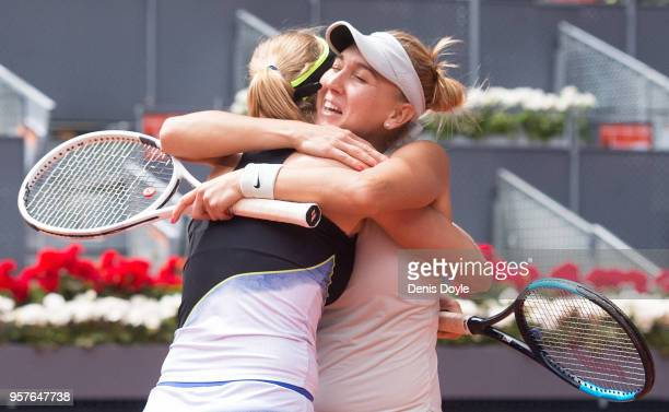 Elena Vesnina and Ekaterina Makarova of Russia celebrate match point against Timea Babos of Hungry and Kristina Mladenovic of France in the womens...