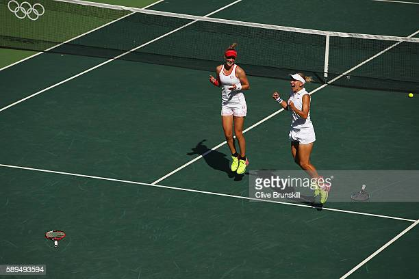 Elena Vesnina and Ekaterina Makarova of Russia celebrate victory in the women's doubles gold medal match against Martina Hingis and Timea Bacsinszky...