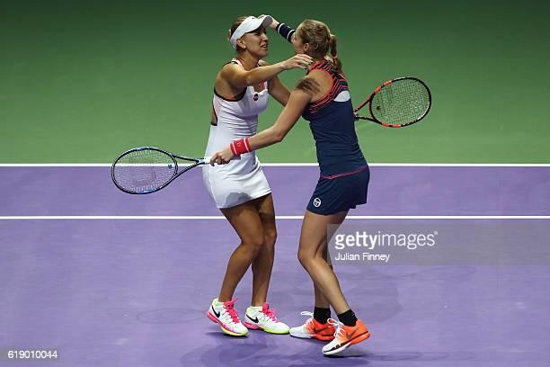 Elena Vesnina and Ekaterina Makarova of Russia celebrate victory in their doubles semifinal against Martina Hingis of Switzerland and Sania Mirza of...