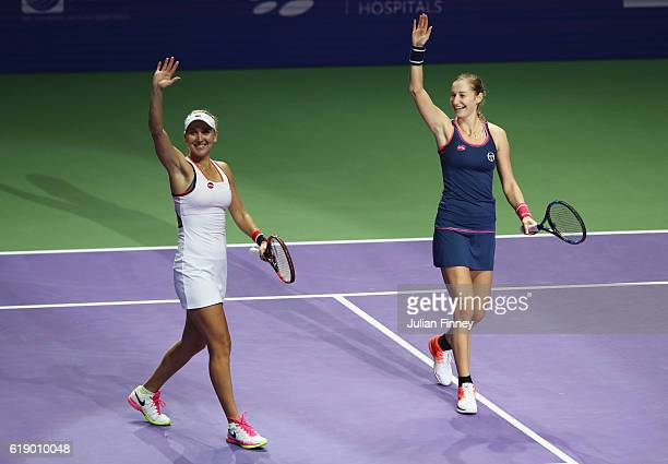 Elena Vesnina and Ekaterina Makarova of Russia celebrate victory in their doubles semifinal against Martina Hingis of Switzerland and Sania Mirza of...