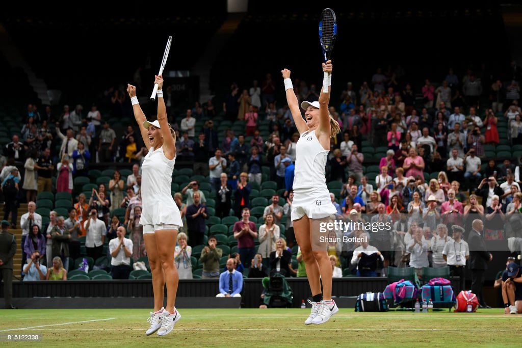 Elena Vesnina (L) and Ekaterina Makarova of Russia celebrate victory in the Ladies Doubles Final against Hao-Ching Chan of Chinese Taipei and Monica Niculescu of Romania on day twelve of the Wimbledon Lawn Tennis Championships at the All England Lawn Tennis and Croquet Club at Wimbledon on July 15, 2017 in London, England.