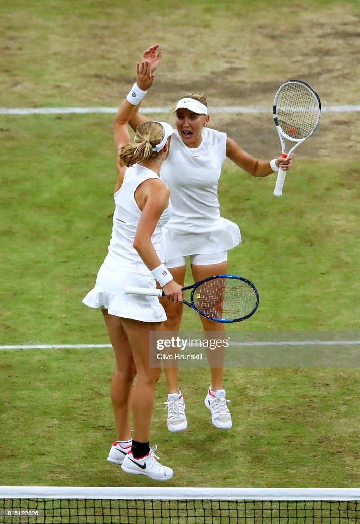 Elena Vesnina (R) and Ekaterina Makarova of Russia celebrate victory in the Ladies Doubles Final against Hao-Ching Chan of Chinese Taipei and Monica Niculescu of Romania on day twelve of the Wimbledon Lawn Tennis Championships at the All England Lawn Tennis and Croquet Club at Wimbledon on July 15, 2017 in London, England.