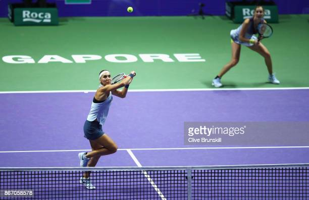 Elena Vesnina and Ekaterina Makarova of Russia in action in the doubles match against YiFan Xu of China and Gabriela Dabrowski of Canada during day 6...