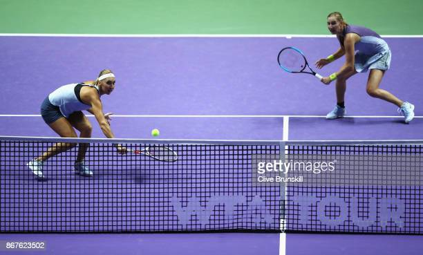 Elena Vesnina and Ekaterina Makarova of Russia in action in the doubles semi final match against Kiki Bertens of Netherlands and Johanna Larsson of...
