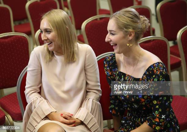 Elena Vesnina and Ekaterina Makarova of Russia smile during day 3 of the BNP Paribas WTA Finals Singapore presented by SC Global at Singapore Sports...