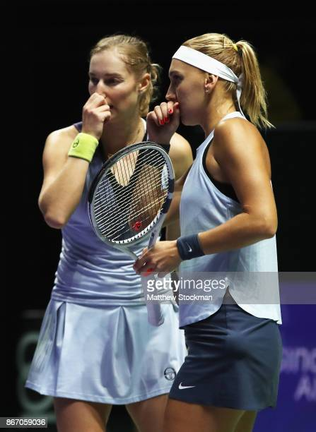 Elena Vesnina and Ekaterina Makarova of Russia talk in the doubles match against YiFan Xu of China and Gabriela Dabrowski of Canada during day 6 of...