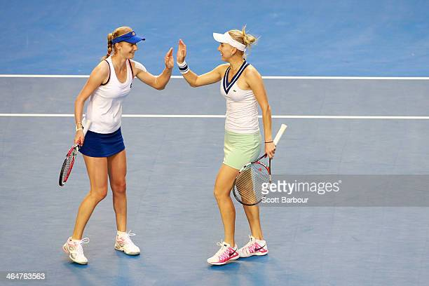 Elena Vesnina of Russia and Ekaterina Makarova of Russia celebrate a point in their doubles final match with against Sara Errani of Italy and Roberta...