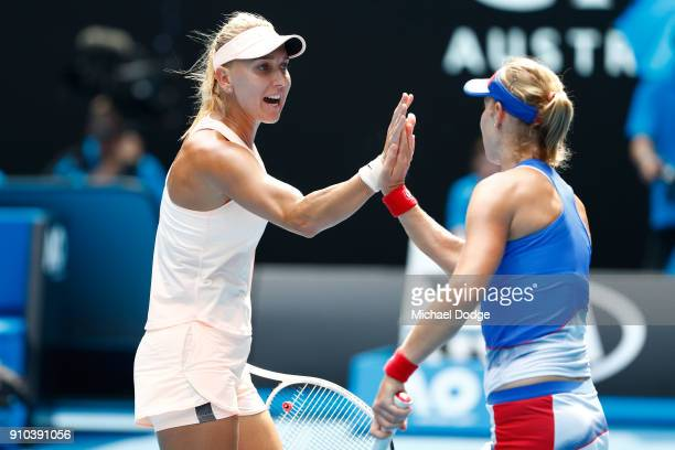 Elena Vesnina of Russia and Ekaterina Makarova of Russia celebrate winning a point in the women's doubles final against Timea Babos of Hungary and...