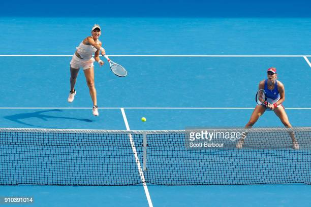 Elena Vesnina of Russia and Ekaterina Makarova of Russia compete in the women's doubles final against Timea Babos of Hungary and Kristina Mladenovic...