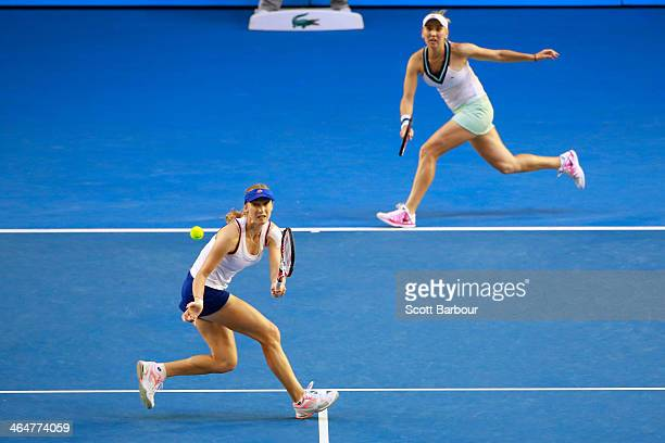 Elena Vesnina of Russia and Ekaterina Makarova of Russia in action in their doubles final match with against Sara Errani of Italy and Roberta Vinci...