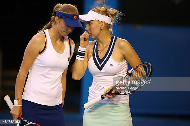 Elena Vesnina of Russia and Ekaterina Makarova of Russia talk tactics in their doubles final match with against Sara Errani of Italy and Roberta...