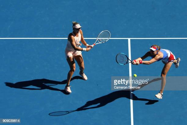 Elena Vesnina of Russia and Ekaterina Makarova of Russia talk tactics in their women's doubles match against Yifan Xu of China and Gabriela Dabrowski...