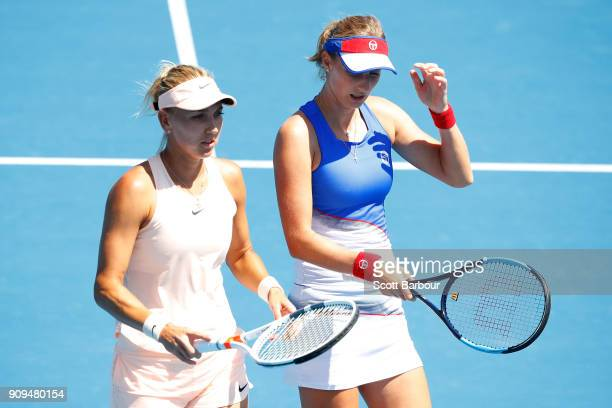 Elena Vesnina of Russia and Ekaterina Makarova of Russia talk tactics in their women's doubles semifinal match against IrinaCamelia Begu of Romania...