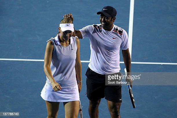 Elena Vesnina of Russia and Leander Paes of India congratulate each other in their semifinal mixed doubles match against Daniele Bracciali of Italy...