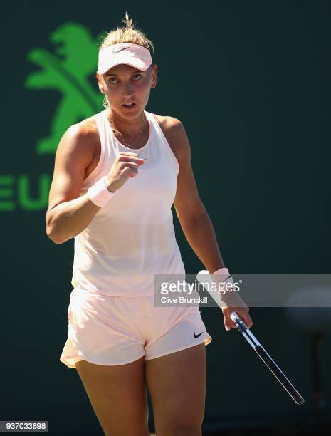 Elena Vesnina of Russia celebrates a point against Donna Vekic of Croatia in their second round match during the Miami Open Presented by Itau at...